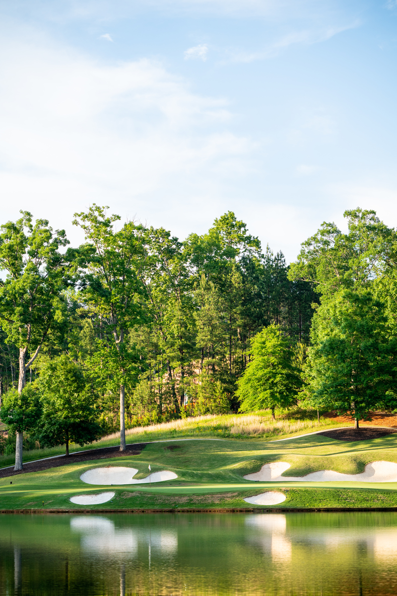 View of a pond on the course at The River Club in Suwanee, Georgia